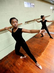 Cayla Oliver, left, and Terra Williams take a dance class at the Inter City Row Modern Dance Company.