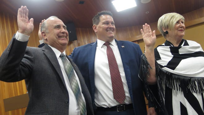 Ed Baca, left, joins Jimmie Hughes and Bette Arial in being sworn in for a four-year term on the St. George City Council on Monday, Jan. 4, 2016.