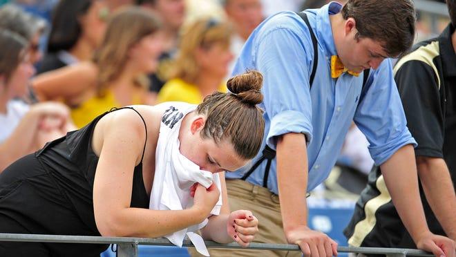 Vanderbilt fans hang their heads in the last minutes of the fourth quarter against Ole Miss at LP Field in Nashville, Tenn., Saturday, Sept. 6, 2014. Vanderbilt lost 41-3.
