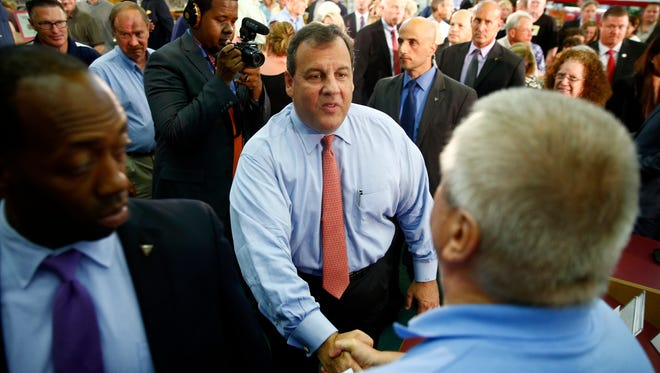 """NJ Governor Chris Christie shakes hands with an audience member after his """"Fairness Formula"""" forum held at the Wall Township library Tuesday, Jun 28, 2016."""