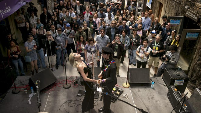 Julia Cumming and Nick Kivlen of Sunflower Bean perform at the FloodFest at Cedar Street Courtyard during South by Southwest in 2018. This year's SXSW festival was canceled because of the pandemic.