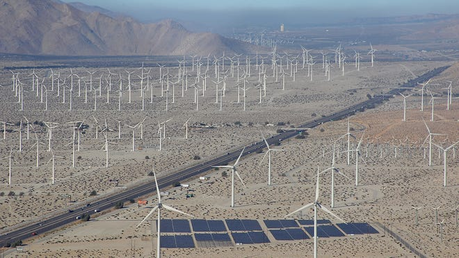 Wind turbines and solar panels dominate the landscape along Interstate 10 near Palm Springs.