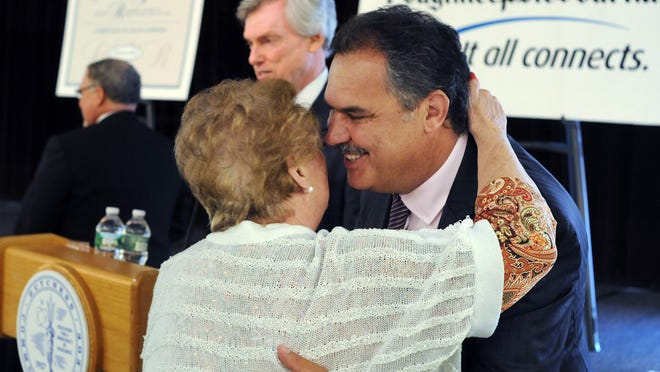 Poughkeepsie Journal Business Person of the Year Joseph Lepore of LCS Companies gets a hug from his mother, Grace Lepore, during the ceremony Tuesday at Dutchess Community College in the Town of Poughkeepsie.