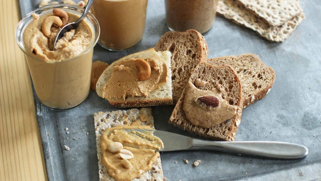 Clockwise from bottom are homemade nut butters, peanut butter, cashew butter and almond butter. This dish is from a recipe by Sara Moulton.