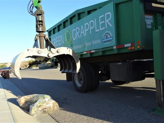 636448022017302765-PHOTO-1-Green-Grappler-clear-bags.JPG