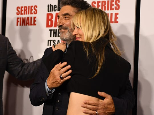 'The Big Bang Theory' co-creator Chuck Lorre, left, and star Kaley Cuoco share a hug on the red carpet at the hit comedy's series wrap party on May 1, the day after the hit sitcom filmed its final episode.