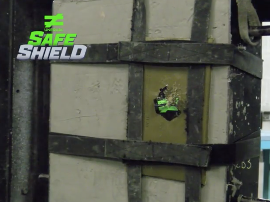 This screen capture from a promotional video provided by Unequal shows the results of shooting the ballistic shield with a shotgun.
