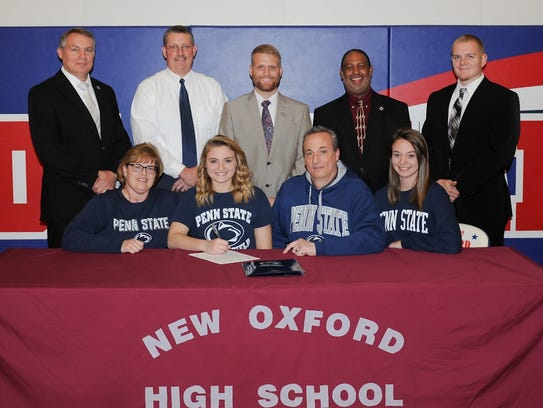 New Oxford's Madi Smith, seated second from left, signs