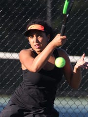 Harrison's Deana Giambo returns a shot during a singles