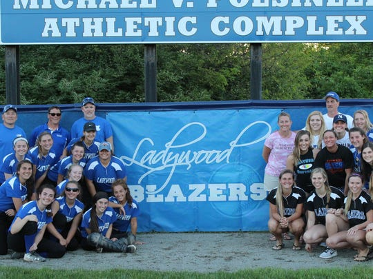 Livonia Ladywood's final softball team (left) poses with Blazers alumnae following Friday's final game ever played at the Michael V. Polsinelli Athletic Complex.