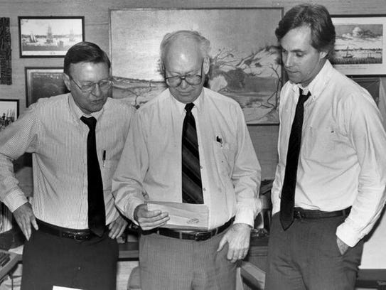 From left, the late Paul Jasper, editorial page editor, Editor J. Earle Bowden and editorial writer Carlton Proctor consult in this undated photo.