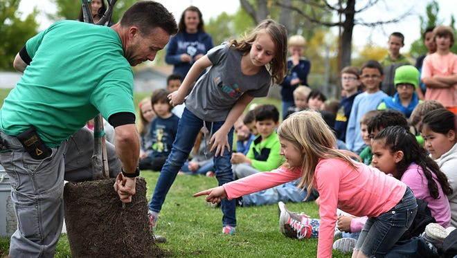 Jesse Hon, an urban forester for the city of Sparks, preps a tree for Juniper Elementary Students to plant for Arbor Day at Aimone Park on April 29.