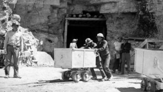 FILE - In this May 7, 1953, file photo, Navajo miners work at the Kerr McGee uranium mine at Cove, Ariz., on the Navajo reservation in Arizona. Kerr-McGee left abandoned uranium mine sites, including contaminated waste rock piles, in the Lukachukai mountains of Arizona and in the Ambrosia Lake area of New Mexico. The Lukachukai mountains are located immediately west of Cove, Ariz., and are a culturally significant part of the Navajo Nation. This site is among thousands that are part of the $5.15 billion settlement with Anadarko Petroleum Corp. with approximate amount of funding for cleanup efforts and details about the sites, in information provided by the Justice Department.