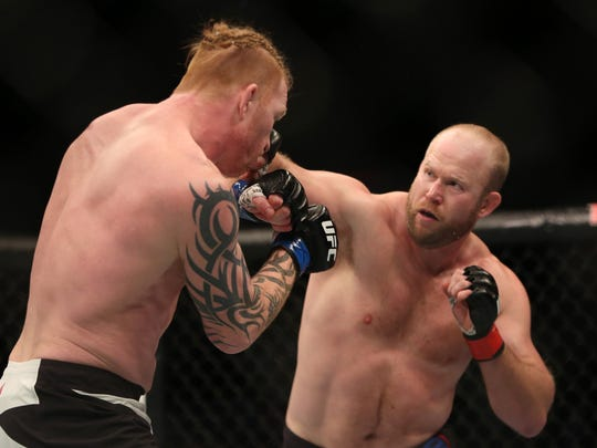 Tim Boetsch, right, in action against Ed Herman in their mixed martial arts bout at UFC Fight Night 81, Sunday, Jan. 2, 2016, in Boston.  Herman won via second round stoppage. (AP Photo/Gregory Payan)