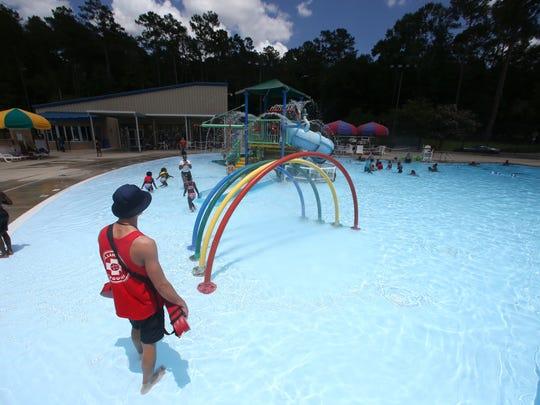 Kids swim at the Jack McLean Aquatics Center Saturday, June 24, 2017.