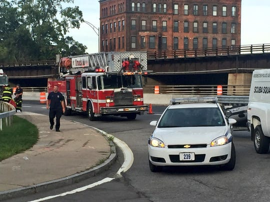 The scuba detail and the Rochester Fire Department respond to a body being found by construction workers near N. Water Street and the Inner Loop.
