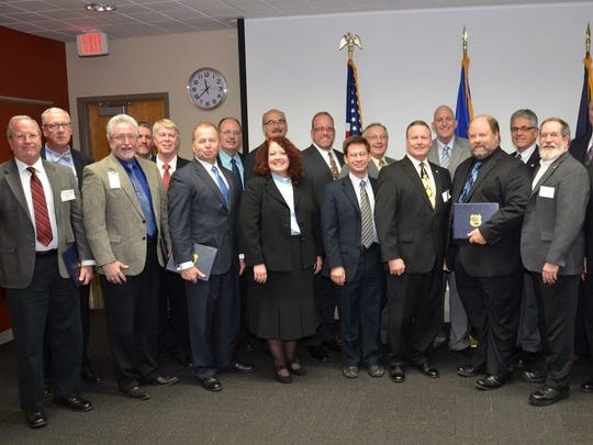 The 20 clergy installed in the new chaplaincy program for the Wisconsin State Patrol in Madison on Dec. 9 included, from left, Kevin Morris of New Richmond, Jef Skinner of Sparta, Tim Blackburn of Racine, Ben Seamans of Reedsburg, Greg Young of Brown Deer, Richard Bartholomew of Omro, Tim Greenwald of Oshkosh, Ellen Rasmussen of Rhinelander, Larry Szyman of Hudson, David Bratlie of Pittsville, Christian Markle of Phillips, Duane Hamilton of Wausau, Mark Clements of La Crosse, Mark Holmes of Superior, Robert Bott of Holmen, George Papachristou of Big Bend, Barry Hoerz of Black Earth, John Putnam of Sheboygan Falls, Raymond Slatton of Wausau and Bob Goodsell of DeForest.