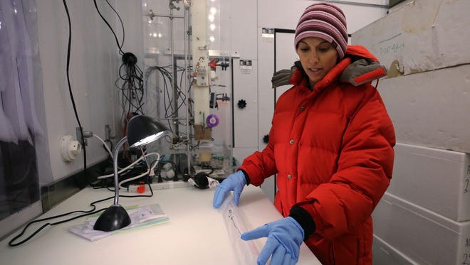 Monica Arienzo works on a 30,000-year-old ice core at the Desert Research Institute, in Reno on Feb. 21, 2018.