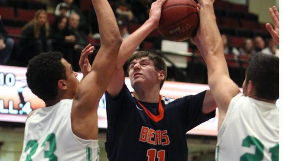 Briarcliff's Spencer McCann shoots between Irvington's