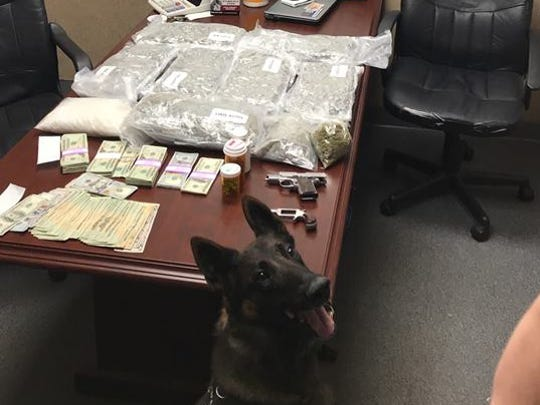 Palm Bay police seized drugs, cash and weapons in late night traffic stop.