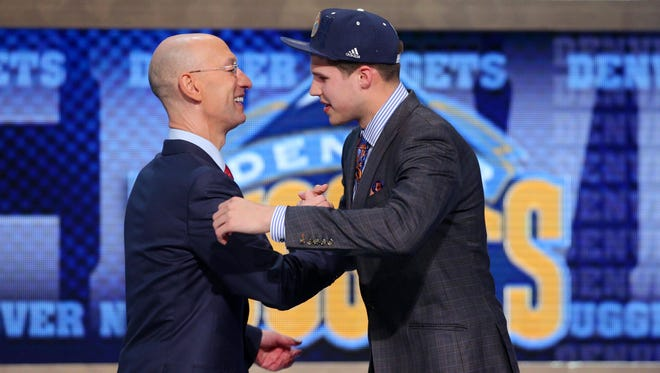 Doug McDermott (Creighton) shakes hands with NBA commissioner Adam Silver after being selected as the No. 11 overall pick to Denver in Thursday's NBA Draft. He was eventually traded to the Chicago Bulls.