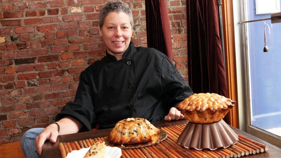 Chef/owner Jill Rose and her Dundee cake, an alternative to the dreaded, non-perishable fruit cake, is photographed at Chiboust, Nov. 26, 2013 in Tarrytown. ( Tania Savayan / The Journal News )