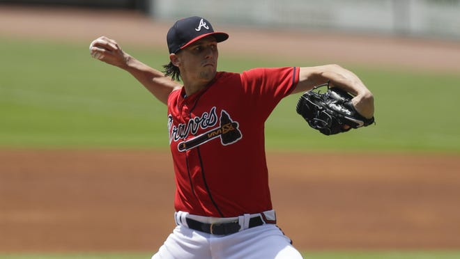 Braves starting pitcher Kyle Wright worked around five hits and four walks in 3 1/3 innings in the 4-0 win over the Mets on Sunday.