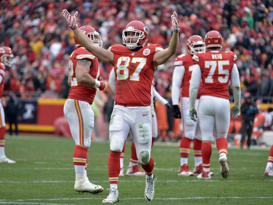 Kansas City Chiefs tight end Travis Kelce (87) celebrates after scoring during the first half against the Cleveland Browns at Arrowhead Stadium.