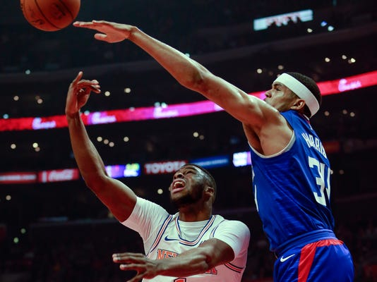 New York Knicks guard Emmanuel Mudiay, left, goes to the basket while while defended by Los Angeles Clippers forward Tobias Harris during the first half of an NBA basketball game Friday, March 2, 2018, in Los Angeles. (AP Photo/Ringo H.W. Chiu)