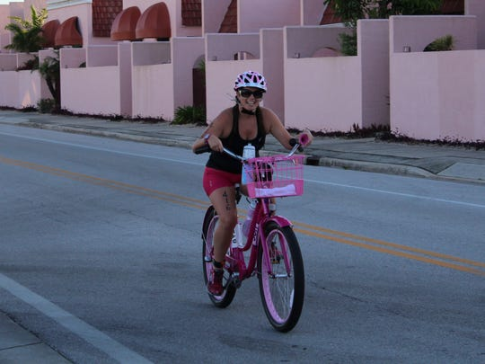 Mandy Gillespie, 37, completed the Ron Jon Cocoa Beach Triathlon on her shiny, pink beach cruiser, winning third place in the female fat tire division.