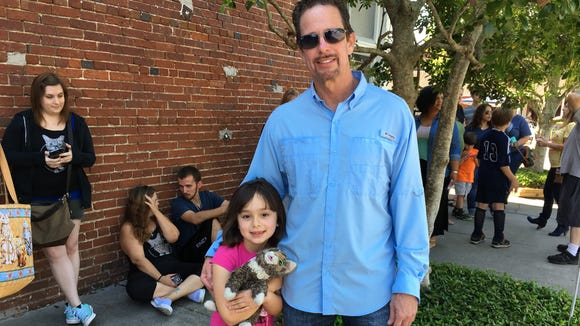 Bruce Johnson and his daughter, Marcela, 7, wait to see Lil Bub on Saturday.