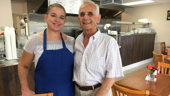 Marika and Nikos Sklavenitis pose in the dining room of Greek Cuisine, which they opened this month next to the Camarillo location of their existing Breakfast Cafe restaurant.