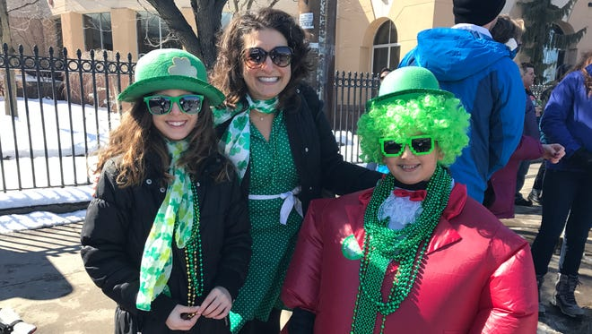 Stacy Russell and her children Brandon and Brianna love the St. Patrick's Day parade. Brandon's outfit got him noticed by Rochester Mayor Lovely Warren, he said.