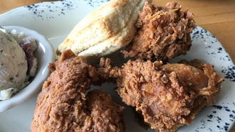 A close-up of the delicious, crispy, craggy coating on the fried chicken at Whistle Britches.