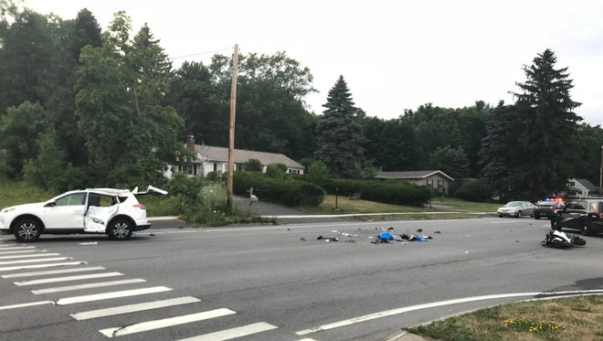Two people were seriously injured when a motorcycle collided with an SUV on Route 250 in Penfield on July 13, 2018.