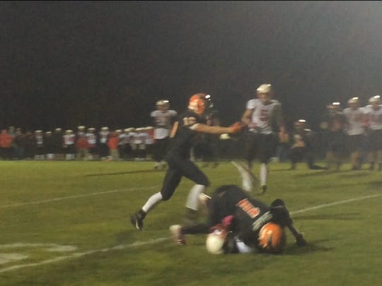 Iola-Scandinavia's Ben Cady hauls in a three-yard touchdown reception near the end of the first half.