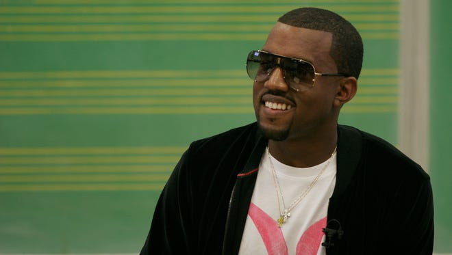 """Musician Kanye West appears at Chicago State University for """"MTVu Stand In"""" September 1, 2005 in Chicago, Illinois. West joins as a surprise professor for the MTVu series, where they bring a cultral icon into the classroom to teach a group of unsuspecting students for the session. West teaches a songwriting master class at the university where he was a """"college dropout""""."""