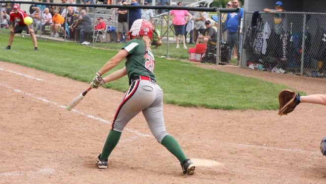 The Rockets' Seree Petersen lifts a hit to right to drive in the winning run. Oak Harbor beat Clyde 9-8 in 8 innings for the District title at Genoa.