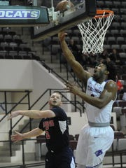 ACU's Jaylen Franklin, right, drives to the basket