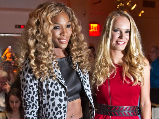 U.S. Open 2014 tennis champion Serena Williams, seen here posing with U.S. Open runner-up Caroline Wozniacki before showing her Spring 2015 collection during Fashion Week on Tuesday, Sept. 9, 2014 in New York, is in Indian Wells for the BNP Paribas Open.