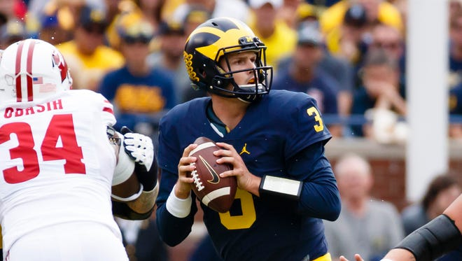 Oct 1, 2016; Ann Arbor, MI, USA; Michigan Wolverines quarterback Wilton Speight (3) drops back to pass in the first quarter against the Wisconsin Badgers at Michigan Stadium.
