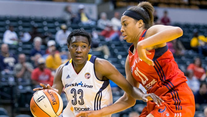 Former FSU standout Natasha Howard of the Indiana Fever drives past Tianna Hawkins of the Washington Mystics in a recent game.