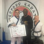 80-year-old earns black belt at Redford Karate