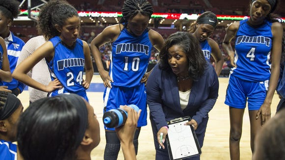 Woodmont girls basketball coach Latrese Davis talks with her team during the Wildcats' 50-47 overtime loss to Wade Hampton in the Class AAAAA Upper State final Feb. 24 at Bon Secours Wellness Arena.