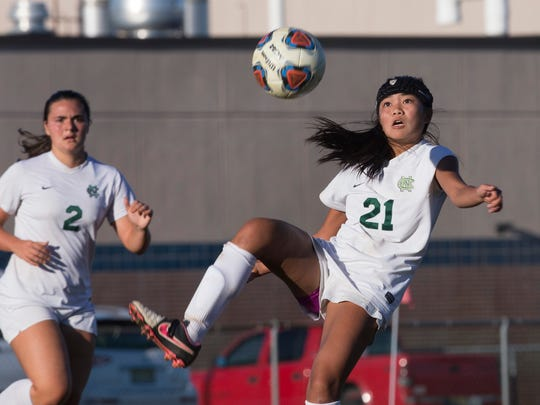 Colts Neck's Kayle Lee kicks the ball towards her goal as team mate Kristen Gambardella looks on. Colts Neck Girls Soccer defeats Middletown North on October 19,  2017 in Colts Neck, NJ.