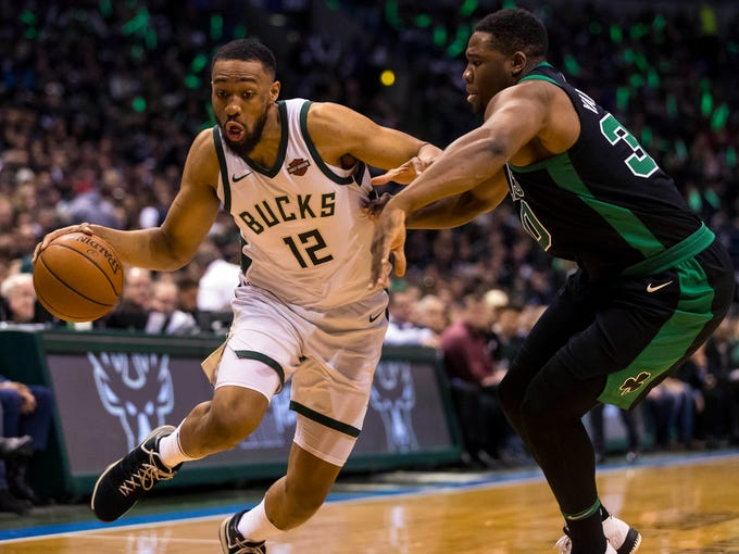Milwaukee Bucks forward Jabari Parker (12) drives for