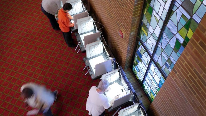 Voters make their ballot choices at the Ward 1, Precinct 2 polling location at The Willows in Worcester on Nov. 3, 2015. The retirement community is not available as a polling place this year because of the coronavirus pandemic.