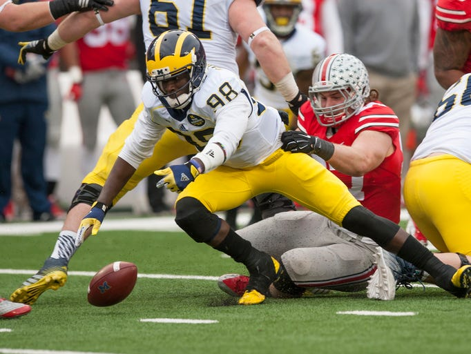 Ohio State defensive lineman Joey Bosa knocks the ball