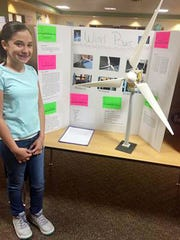 """Grand Champion Winter Lewis shows her project titled """"Wind Power"""" at the Hurley Elementary Science Fair on Wednesday."""