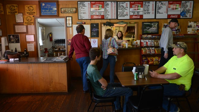 Customers gather at Wolff's Sandwich Shoppe in Atlantic, Va. during the lunch rush on Tuesday, April 22, 2014. Owner Ron Wolff recently celebrated 30 years of business at the location.